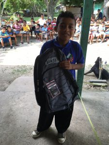 RE/MAX Estate Properties Give Donate Backpacks Shoes Kids Belize